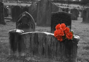 119829-blank-headstone-in-graveyard-with-bunch-of-red-roses